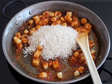 nacarar el arroz albufera en la paella
