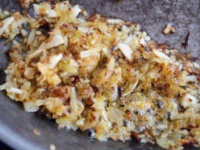 cebolla y ajos pochados en paella